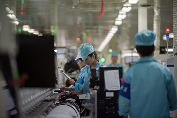 中國大陸一處工廠流水線。(AFP/Nicolas ASFOURI /Julien GIRAULT)