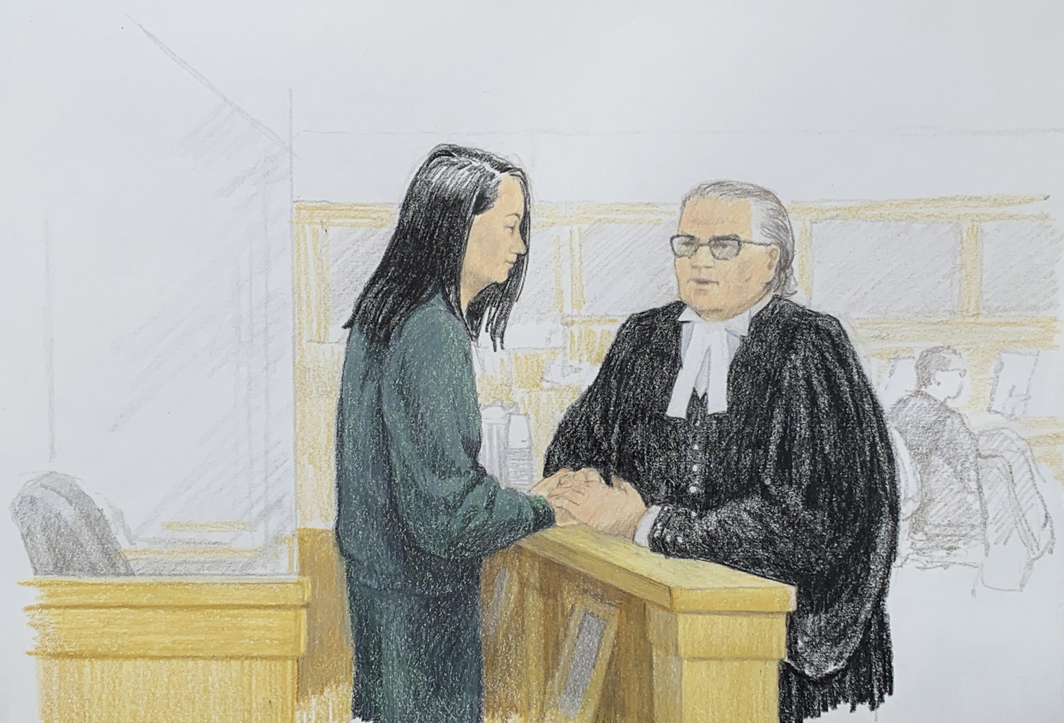 孟晚舟在12月10日保釋庭上與她的律師說話。(Jane Wolsak/Jane Wolsak/AFP)