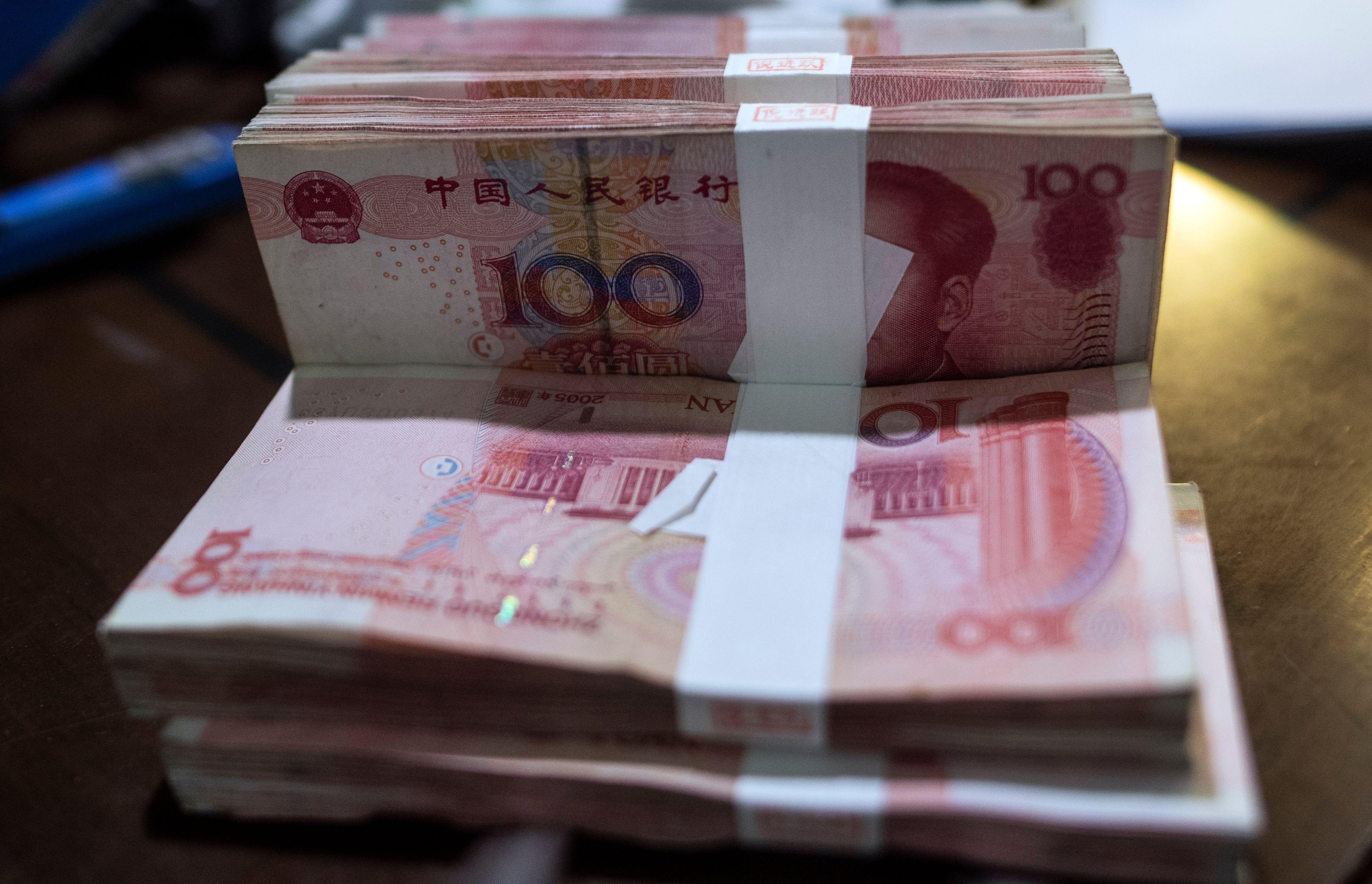 2018年,中國經濟下行,通脹加劇,外貿形勢嚴峻等,都是人民幣貶值的壓力源。(JOHANNES EISELE/AFP/Getty Images)
