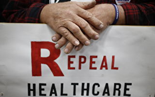 LOUISVILLE, KY - OCTOBER 31: Supporter James Hughes of Louisville, Ky. holds a sign calling for the repeal of the Affordable Care Act during a rally for Senate Minority Leader Mitch McConnell (R-KY) at Brandeis Machinery & Supply Company on October 31, 2014 in Louisville, Kentucky. With less than a week remaining until election day McConnell maintains a slight edge over Democratic challenger Kentucky Secretary of State Alison Lundergan Grimes in recent polls. (Photo by Luke Sharrett/Getty Images)