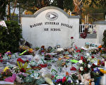 US-CRIME-SCHOOL-SHOOTING Flowers, candles and mementos sit outside one of the makeshift memorials at Marjory Stoneman Douglas High School in Parkland, Florida on February 27, 2018. Florida's Marjory Stoneman Douglas high school will reopen on February 28, 2018 two weeks after 17 people were killed in a shooting by former student, Nikolas Cruz, leaving 17 people dead and 15 injured on February 14, 2018. / AFP PHOTO / RHONA WISE (Photo credit should read RHONA WISE/AFP/Getty Images)