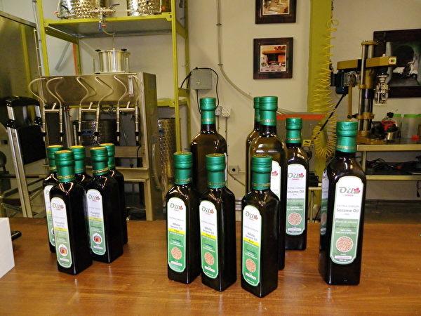 Oila Canada採用傳統的低溫壓榨法,從食物中提出特級初榨食用油。圖為該公司陳列的食用油產品。(易文/大紀元)