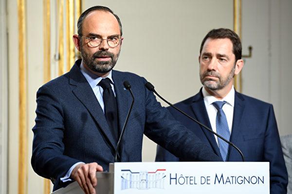 3月25,法國總理菲利普(Édouard Philippe)(左)宣布了内閣通過了針對中共肺炎疫情的25項法令。(Bertrand GUAY / AFP)