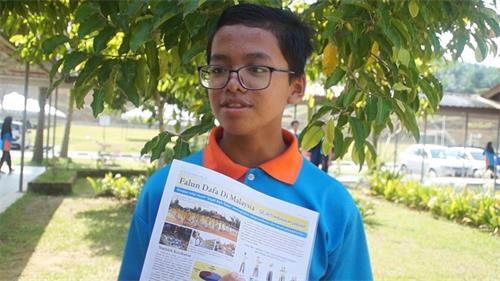 學生Muhammad Nur Syamil煉法輪功後,心情好轉。(明慧網)