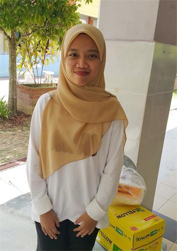 實習老師Nurul Hanna表示,法輪功學員的到來,特別是給學生們教功,這對他們而言非常受益。(明慧網)