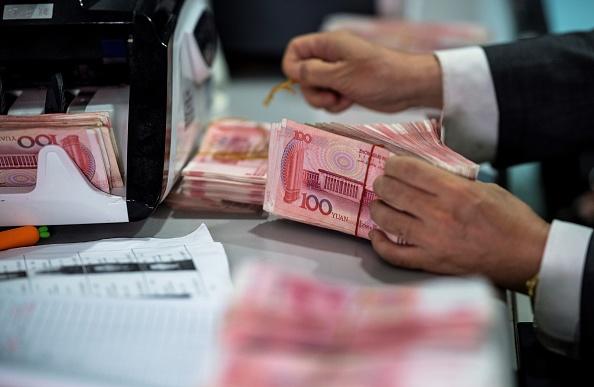 中國人民銀行高級官員3月18日表示,中國金融業的「灰犀牛」風險正在上升。(Johannes Eisele/AFP/ Getty Images)