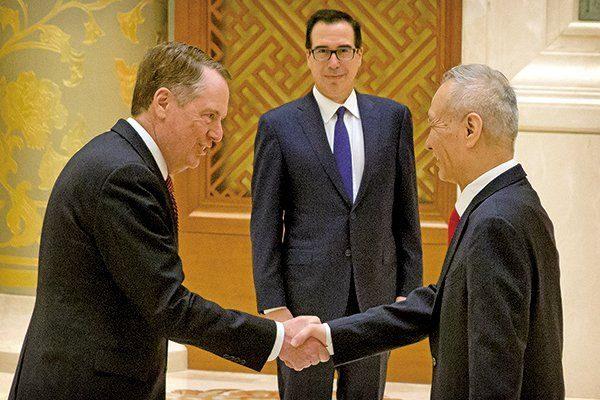 圖為中美在北京貿易談判場景。(AFP)