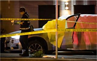 4月16日晚,溫哥華西區Kitsilano社區發生一起槍擊案,一男子在車內被槍擊身亡。圖為驗屍官在一輛車旁做記錄。(加通社)