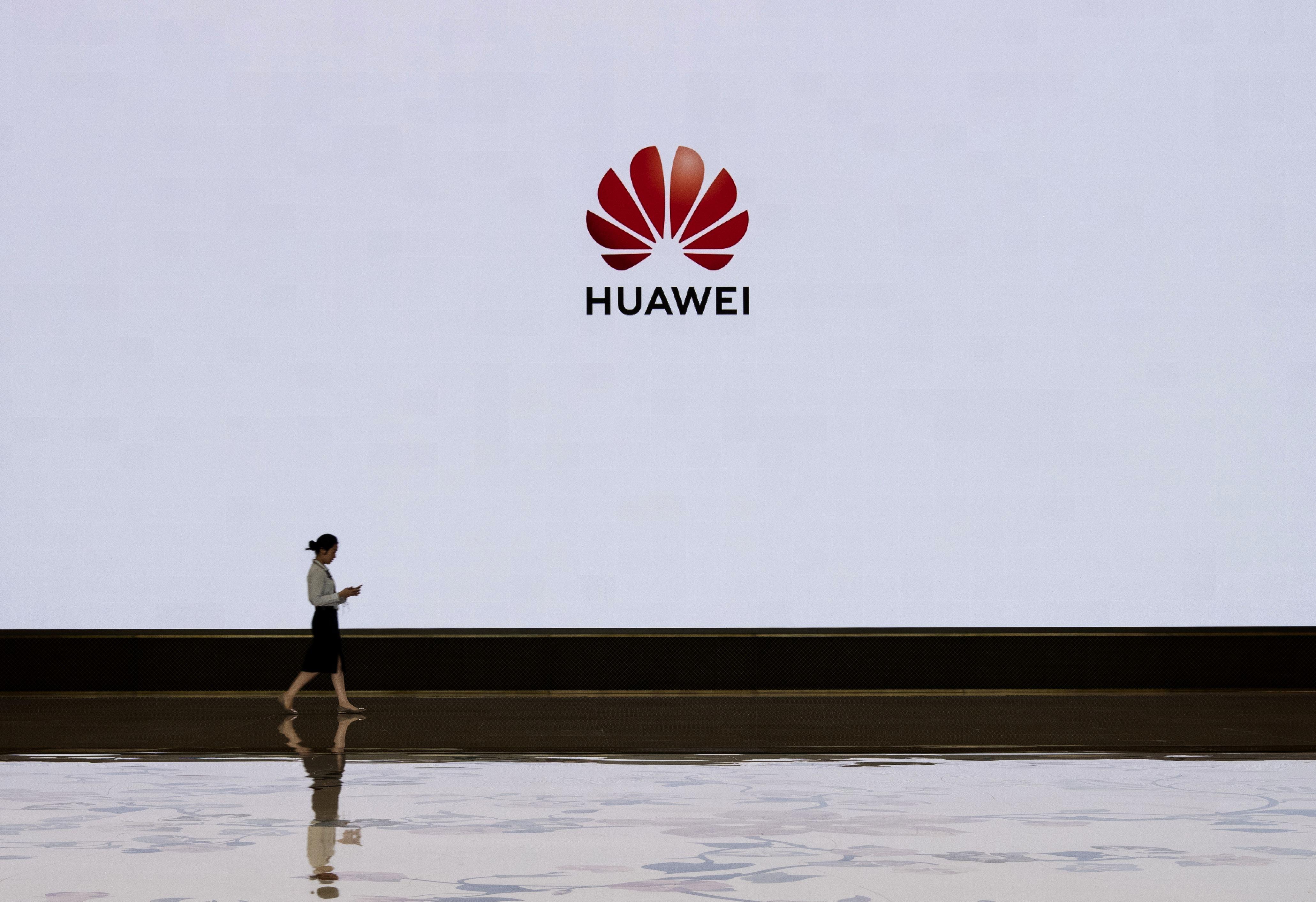 中共及受其控制的中國公司(例如華為)正在加緊招募「華府沼澤」,美國國會已注意到這個情況,並且提出法案阻止華府政治人物為外國政府遊說。 (Kevin Frayer/Getty Images)