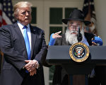 "President And Mrs Trump Host National Day Of Prayer Service At White House WASHINGTON, DC - MAY 02: U.S. President Donald Trump (L) listens to Congregation Chabad Rabbi Yisroel Goldstein of Poway, California, speak during a National Day of Prayer service in the Rose Garden at the White House May 02, 2019 in Washington, DC. Goldstein suffered defensive wounds when a gunman opened fire during the last day of Passover services at his synagogue, killing Lori Kaye. The White House invited leaders from various faiths and religions to participate in the day of prayer, which was designated in 1952 by the United States Congress to ask people ""to turn to God in prayer and meditation."" (Photo by Chip Somodevilla/Getty Images)"