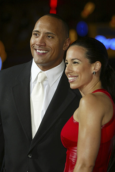 "LOS ANGELES - SEPTEMBER 22: Actor Dwayne ""The Rock"" Johnson and his wife Dany Garcia arrive at the premiere of ""The Rundown"" at the Universal Amphitheatre on September 22, 2003 in Los Angeles, California. (Photo by Kevin Winter/Getty Images)"