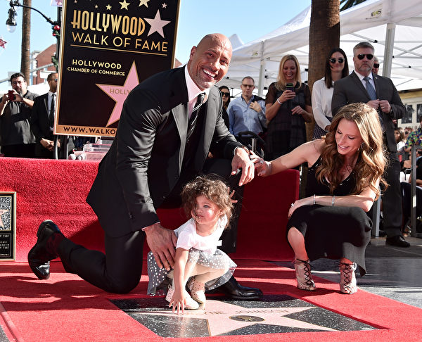 HOLLYWOOD, CA - DECEMBER 13: Actor Dwayne Johnson, Jasmine Johnson and singer Lauren Hashian attend a ceremony honoring Dwayne Johnson with the 2,624th star on the Hollywood Walk of Fame on December 13, 2017 in Hollywood, California. (Photo by Alberto E. Rodriguez/Getty Images)