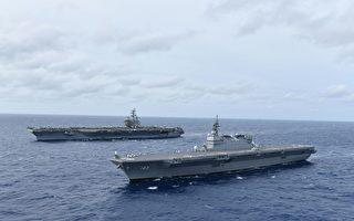 提升区域安全稳定 美日航母在南海联合操演