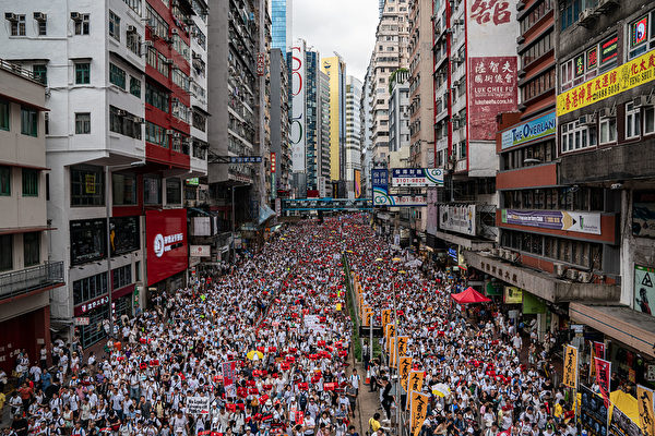 HONG KONG, HONG KONG - JUNE 09: Protesters march on a street during a rally against the extradition law proposal on June 9, 2019 in Hong Kong. Hundreds of thousands of protesters marched in Hong Kong in Sunday against a controversial extradition bill that would allow suspected criminals to be sent to mainland China for trial.(Photo by