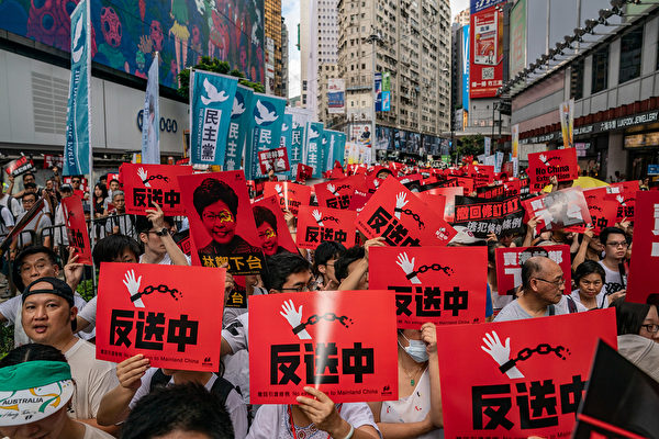 HONG KONG - JUNE 09: Protesters hold placards and shout slogans during a rally against a controversial extradition law proposal on June 9, 2019 in Hong Kong. Organizers say more than a million protesters marched in Hong Kong on Sunday against a bill that would allow suspected criminals to be sent to mainland China for trial as tensions have escalated in recent weeks. (Photo by