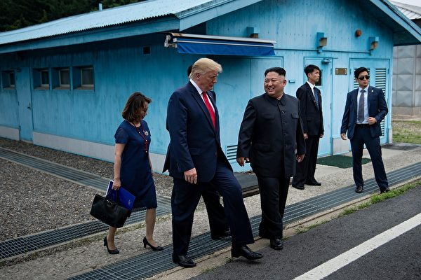North Korea's leader Kim Jong Un and US President Donald Trump walk together south of the Military Demarcation Line that divides North and South Korea, after Trump briefly stepped over to the northern side, in the Joint Security Area (JSA) of Panmunjom in the Demilitarized zone (DMZ) on June 30, 2019. (Photo by Brendan Smialowski / AFP)