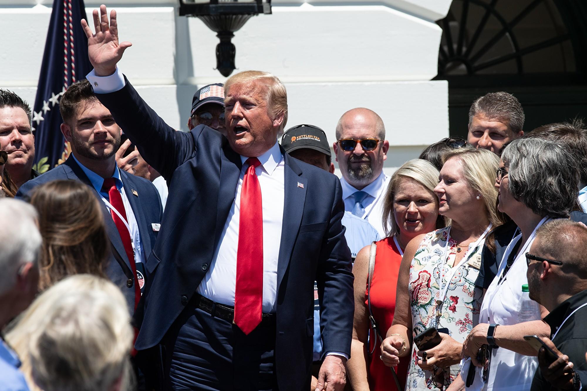 特朗普說,美國農民是愛國者,沒有一個農民告訴他要快速達成協議。(NICHOLAS KAMM/AFP/Getty Images)