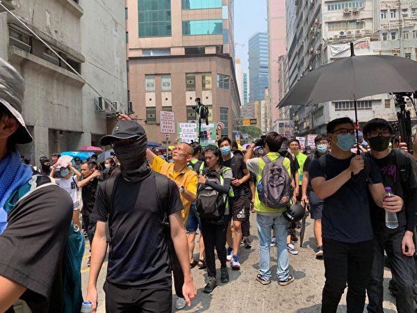 2019年8月24日,港人舉辦「清除雜草 觀塘開花」九龍東觀塘大遊行。(駱亞/大紀元)