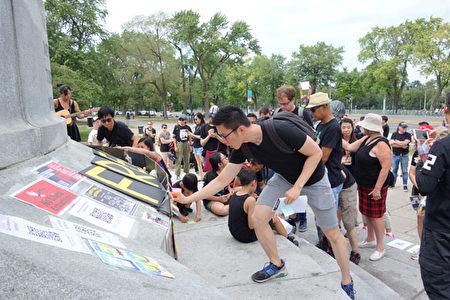8月3日下午,滿地可民眾響應「加國7城聯手 抗暴救港」活動,在Mont-Royal公園集會聲援港人五大訴求。(譚雅/大紀元)