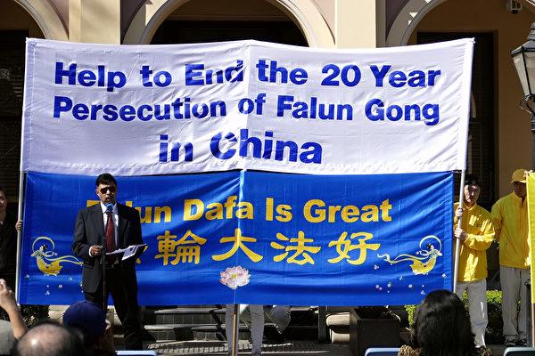 帕拉馬塔市聯邦自由黨候選人洛克(Ganesh Loke)在悉尼法輪功學員舉行的反迫害集會上發言。(安平雅/大紀元)