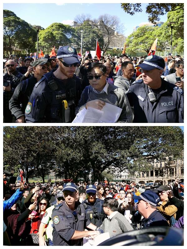 2019年8月17日,在悉尼的親中集會上,警察保護著鍾錦江博士離開圍困他的人群。(安平雅/大紀元)