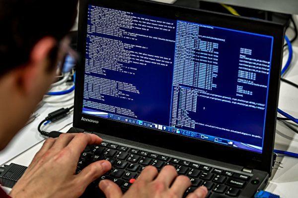 在當今互聯網的世界中,中共的黑客仍然扮演著中共知識產權盜竊中的最大角色之一。(JOHN MACDOUGALL/AFP/Getty Image)