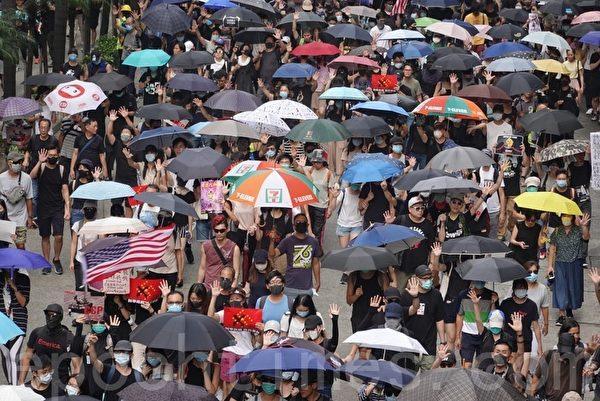2019年9月29日,全球24個國家、65個城市舉行「全球連線-共抗極權」遊行。圖為遊行隊伍經過灣仔。(孫明國/大紀元)
