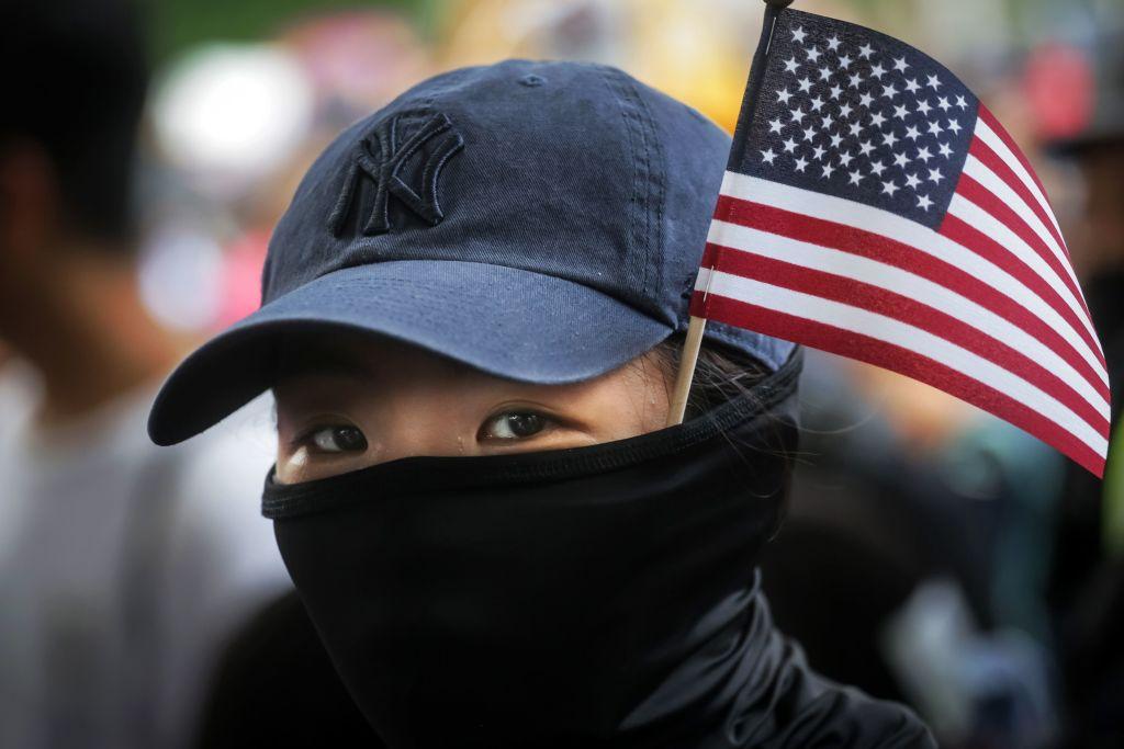 揭露中共謠言 港人為悼念9.11暫停抗議