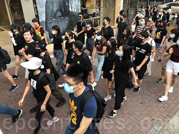 2019年10月5日,香港民眾發起港島遊行,尖沙咀彌敦道。(黃曉翔/大紀元)