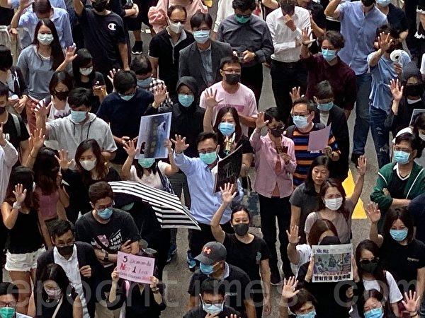 2019年10月18日,中環打工仔快閃 遮打花園集會遊行。(駱亞/大紀元)