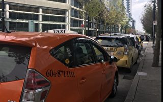 10月2日(星期三),溫哥華市議會投票通過了針對網約車申領牌照及街道使用權限的相關法規。(祖文/大紀元)