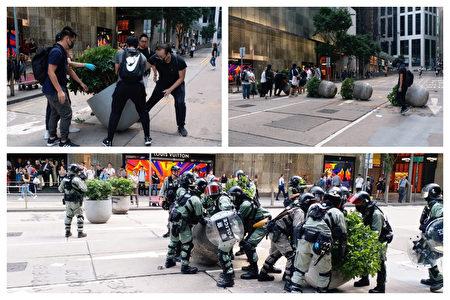在香港金融中心畢打街,學生搬動花盆堵路。一群警察過來將花盆搬回路邊,學生又將花盆移回路中心。(受訪者提供)
