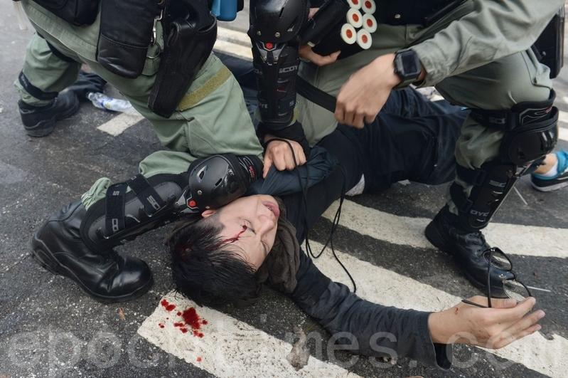 麥康奈爾:支持香港民主抗議者 推動立法
