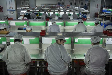 台灣經濟部長沈榮津2019年11月5日表示,中國(中共)對台措施,只是表面「友台」,所幸台灣企業都已看清楚了。圖為台商工廠示意圖。 (Kevin Frayer/Getty Images)