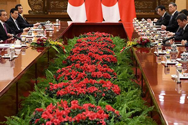 安倍和习近平会面 促保持香港自由开放