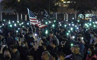 """12月23日7时,为了声援遭港警拘捕的""""星火同盟""""成员,香港民间在中环爱丁堡广场举行""""星火不息,燃点国际""""集会。(大纪元视频截图)"""