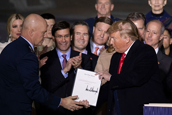 President Trump Signs National Defense Authorization Act At Joint Base Andrews JOINT BASE ANDREWS, MARYLAND - DECEMBER 20: Operations Chef John Raymond and US President Donald Trump at the signing ceremony for S.1709, The National Defense Authorization Act for Fiscal Year 2020 on December 20, 2019 in Joint Base Andrews, Maryland. President Trump is headed to Florida for the Holidays after a historic impeachment vote on the house floor this week. (Photo by Tasos Katopodis/Getty Images)