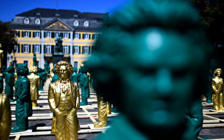 Sculptures representing German composer Ludwig van Beethoven and made by conceptual artist Ottmar Hoerl are displayed on May 15, 2019 at the Muensterplatz square in Bonn, western Germany. - Around 700 sculptures by the artist are displayed in the city until June 2, 2019 as part of the festivities to mark the 250th anniversary of Beethoven's birth. (Photo by INA FASSBENDER / AFP) / RESTRICTED TO EDITORIAL USE - MANDATORY MENTION OF THE ARTIST UPON PUBLICATION - TO ILLUSTRATE THE EVENT AS SPECIFIED IN THE CAPTION (Photo credit should read INA FASSBENDER/AFP via Getty Images)