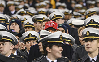 US President Donald Trump watches the game with members of the Navy during the Army-Navy football game in Philadelphia, Pennsylvania on December 14, 2019. (Photo by Andrew CABALLERO-REYNOLDS / AFP) (Photo by ANDREW CABALLERO-REYNOLDS/AFP via Getty Images)