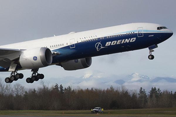 777X是新一代寬體飛機的代表。(Photo by Jason Redmond / AFP)