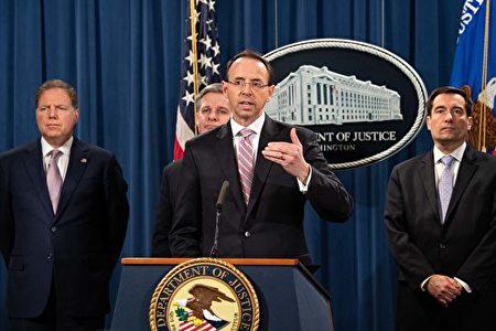 圖為2018年12月20日,美國司法部宣佈,對兩名中共國安部黑客組織成員提起訴訟。這兩名中國公民被指入侵全球雲服務商,盜竊多家商業企業的知識產權和機密信息。(NICHOLAS KAMM / AFP)
