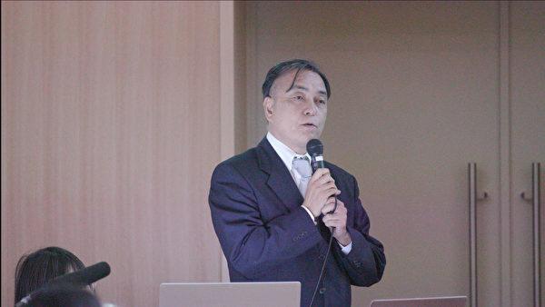 圖為日本的移植旅遊考慮會(SMG Network)SMG事務局長野村旗守,於2019年11月30日在日本東京大學聯合主辦的針對器官販運及移植旅遊的亞洲 研討會分析了一直以來日本媒體及政界甚少報道中國買賣器官等相關人權議題的原因。(新唐人提供)