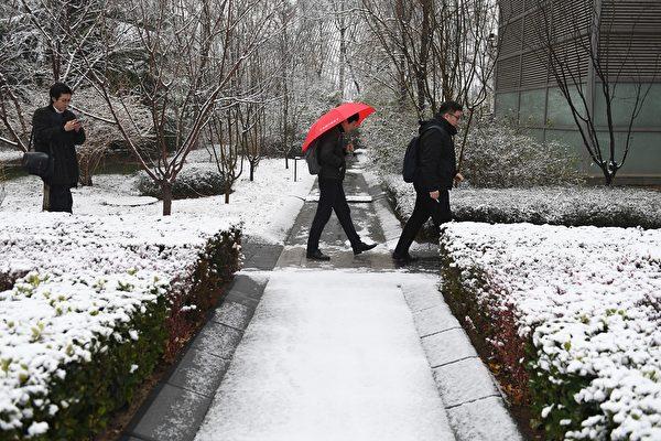 2019年12月16日,北京降雪情况。(GREG BAKER/AFP via Getty Images)