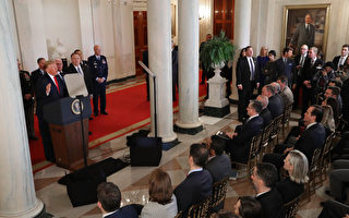 President Trump Addresses The Nation After Iranian Attacks In Iraq Target Bases Where U.S. Troops Stationed WASHINGTON, DC - JANUARY 08: With a portrait of former U.S. President George W. Bush hanging in the Grand Foyer (R), President Donald Trump speaks from the White House January 08, 2020 in Washington, DC. During his remarks Trump addressed the Iranian missile attacks that took place last night in Iraq. (Photo by Chip Somodevilla/Getty Images)