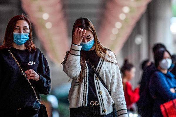 中共肺炎(俗稱武漢肺炎)病人痊癒後,複檢病毒再次呈陽性,可能是何原因?(ANTHONY WALLACE/AFP via Getty Images)