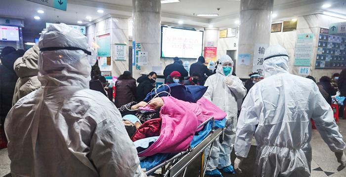 中共肺炎爆發後,中共當局一直隱瞞疫情,致使疫情迅速蔓延。(HECTOR RETAMAL/AFP via Getty Images)