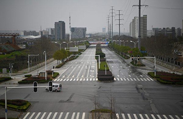 2020年3月4日,湖北武漢,街道上空蕩蕩。(NOEL CELIS/AFP via Getty Images)