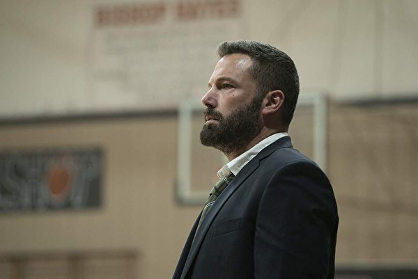 "Ben Affleck plays a former Catholic high school basketball star who returns as a coach while battling alcoholism in ""The Way Back."" (Warner Bros.)"