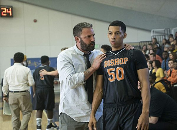 "Ben Affleck (L) and Melvin Gregg as coach and player in ""The Way Back."" (Warner Bros.)"