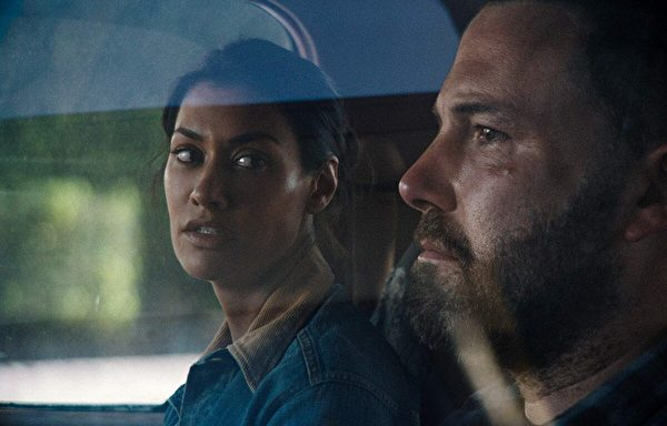 "Janina Gavankar and Ben Affleck play a divorced couple in ""The Way Back."" (Warner Bros.)"